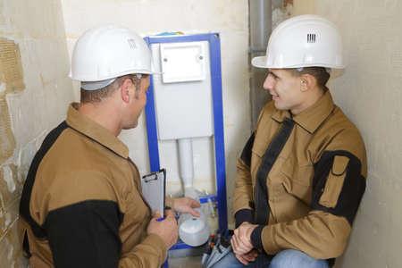 apprentice and mentor working at construction site Reklamní fotografie