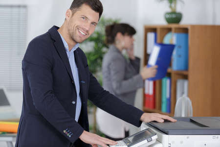 happy worker using printer