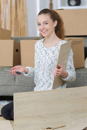 woman carpenter assembling two boards together Reklamní fotografie