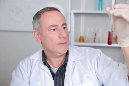 doctor holding blood tube