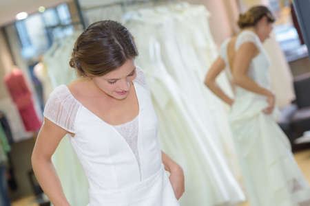 woman fitting a wedding gown Standard-Bild