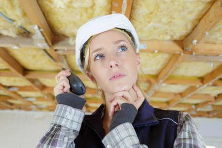 woman using walkie talkie indoors