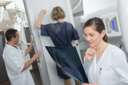 female doctor checking xray