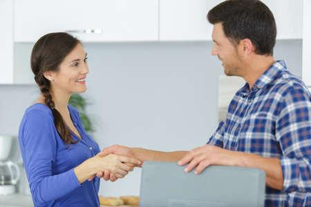 repairman shaking hands with female customer