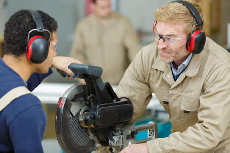 student in carpentry class using circular saw