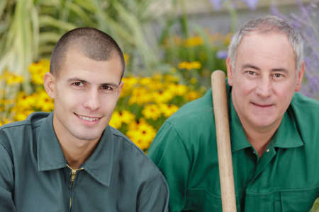 portrait of 2 gardeners in garden