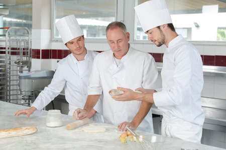 pastry chef watching students preparing delicious pastries