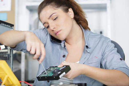tradeswoman using a power tool Stockfoto