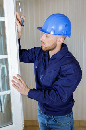 tradesman working on pvc window