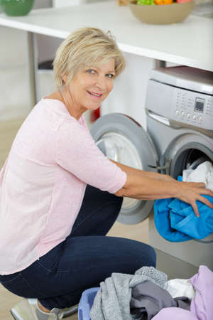elderly woman doing the laundry