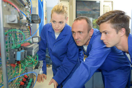 Instructor with two trainee electricians