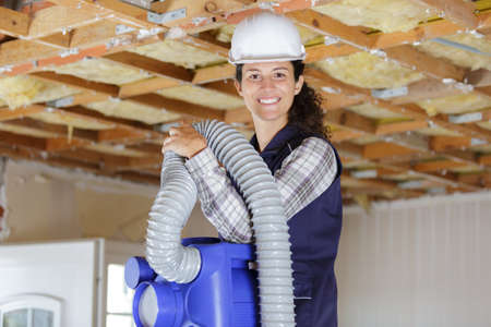 female operator inspecting heating ventilated and air conditioning
