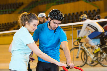 female athlete training in the velodrome with coach