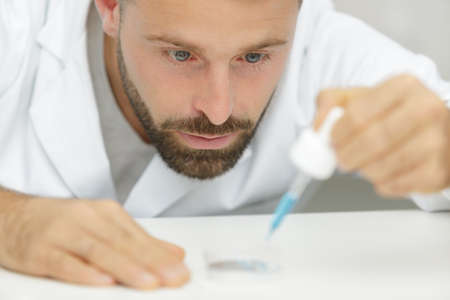 portrait of a laboratory worker with a pipette