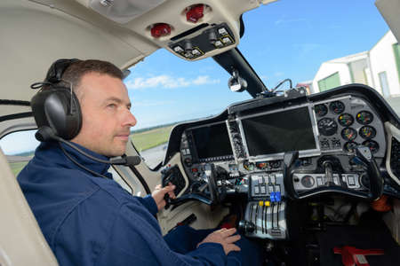 Man in cockpit of aircraft