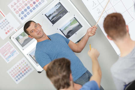 man giving road safety theory lesson in classroom Reklamní fotografie