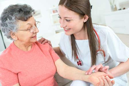 pleasant professioanl doctor examining her patient