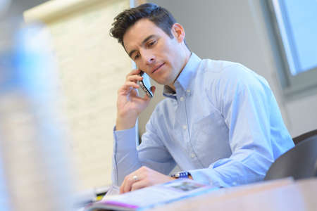 man in the office with mobile phone