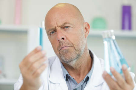 a male doctor analyzing sample Stok Fotoğraf