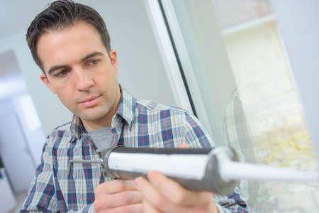 a glazier sealing a glass