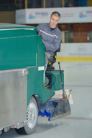 portrait of an ice skating rink cleaning
