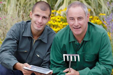 portrait of 2 gardeners relax outdoors Reklamní fotografie