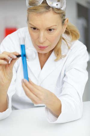 pretty female science researcher in lab