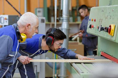 carpenters checking floorplan for next proyect