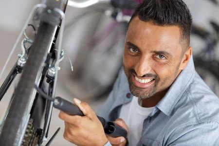 man pumping up a bike tire
