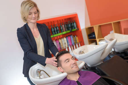 wetting the clients hair Standard-Bild