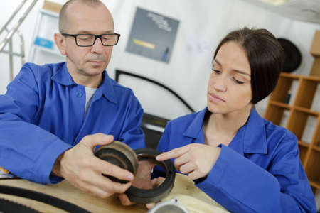 an apprentice in the metal industry with her mentor Reklamní fotografie