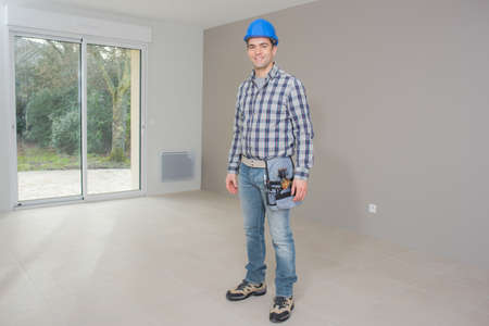 young handsome architect standing in finished house