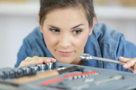 woman next to tool box