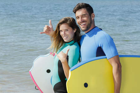 young couple of bodyboard surfers r