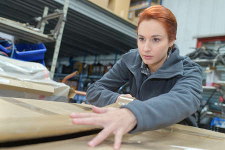 portrait of female worker in warehouse Banque d'images