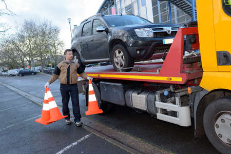 Man hauling a car
