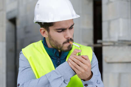 smoking cigarette on construction site