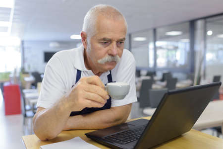 senior man holding a cup of coffee