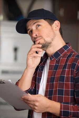 contemplative serviceman holding a clipboard 写真素材