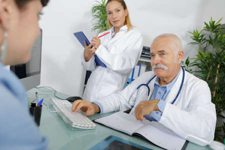 intern observing a doctor Stock Photo