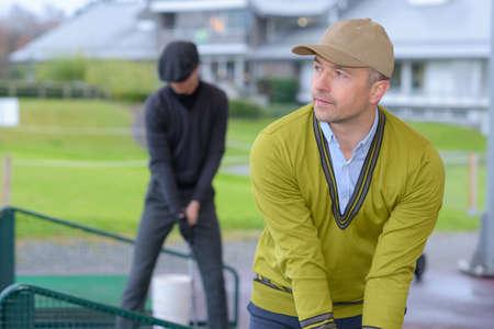 close up of golfer practising