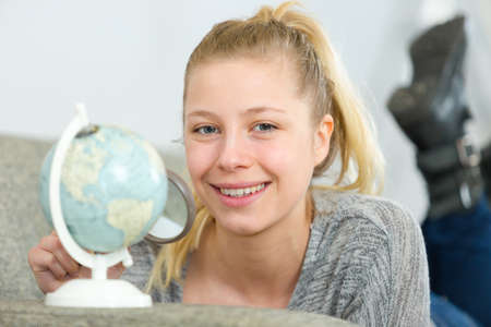 young woman holding a world