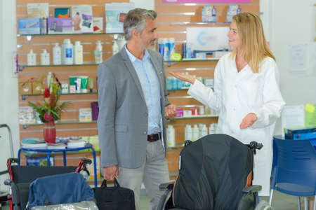 pharmacist giving assistance to a customer