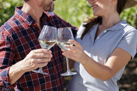 couple with glasses of white wine outdoors