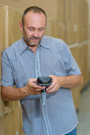 male warehouse worker with barcode scanner