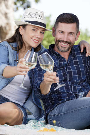 wine grower couple at vineyard toasting and tasting their wine