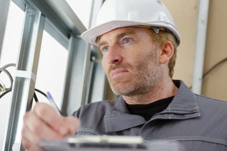 builder or maintenance man with clipboard