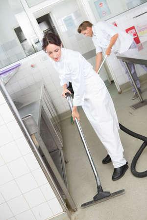 kitchen staffs cleaning the floor
