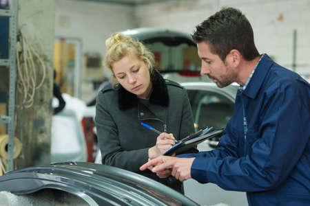 automotive body painter making his diagnostic 写真素材