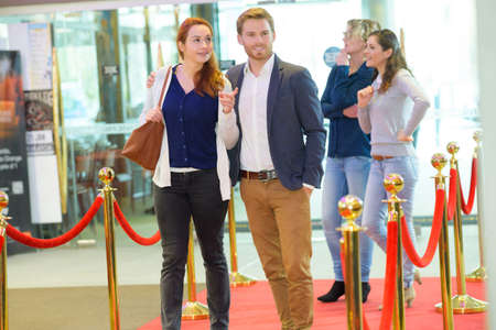 couple in cinema lobby